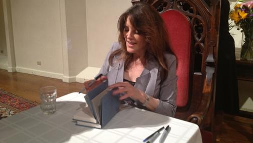 Marianne Williamson signing books