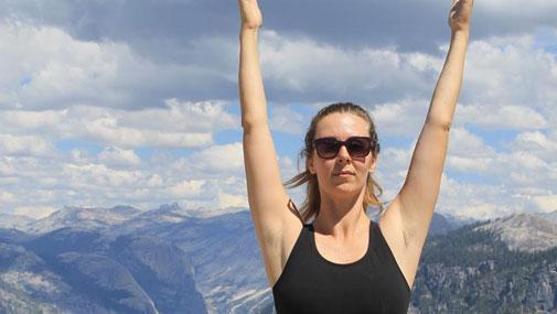 Dustienne Miller in mountain pose on Yosemite Mountain
