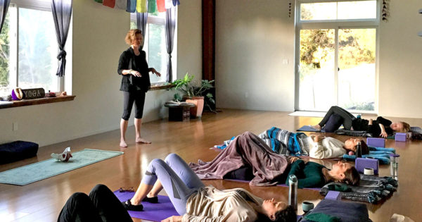 Dustienne teaching at Return to Your Root Retreat