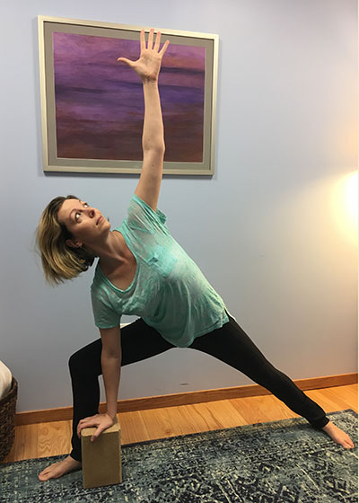 Using a block during extended side angle pose can provide support during prenatal yoga