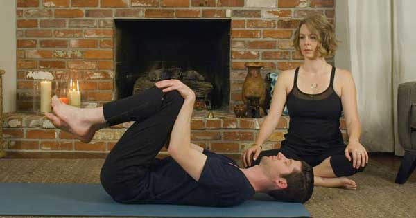 Double knee to chest yoga pose