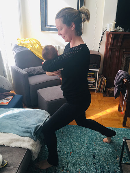 Doing a split squat while holding a baby