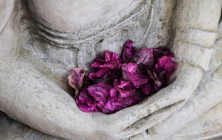 Stone statue with flowers representing kegels