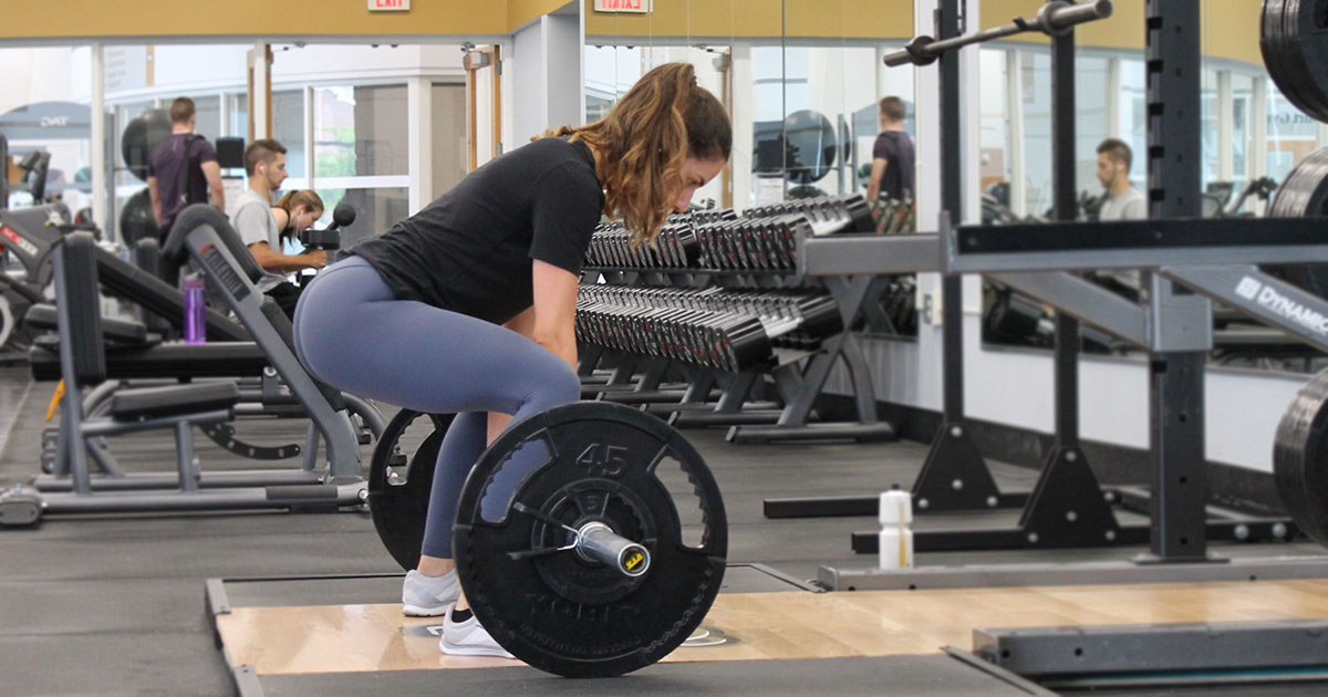 Woman poised to start a deadlift