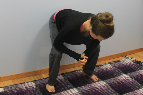 Begin in a squat for an active hamstring stretch